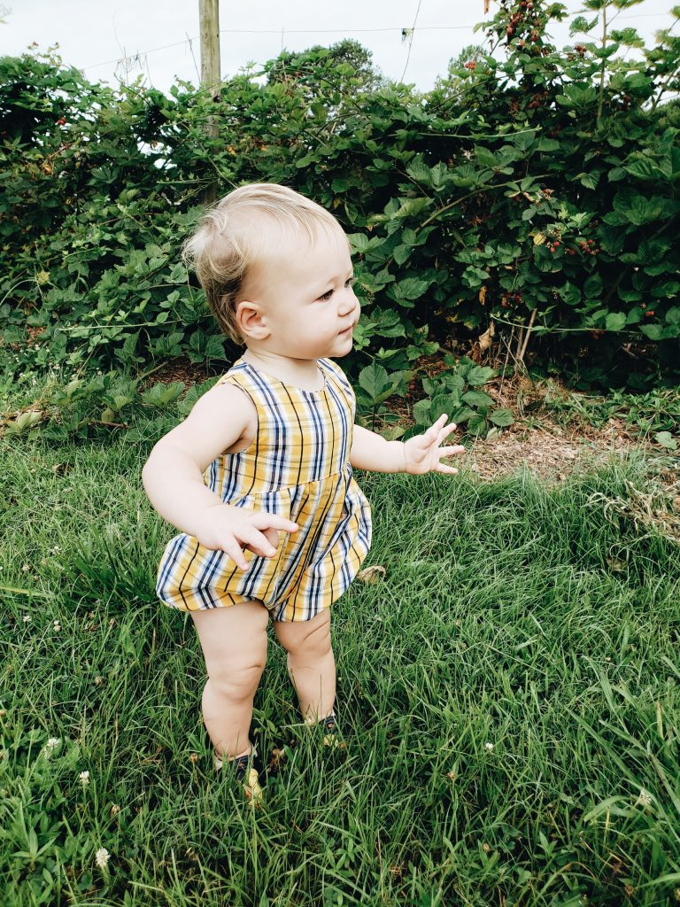 Baby boy wearing romper made by All The Tiny Rebels.