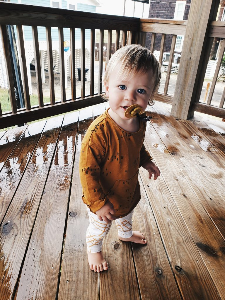 Toddler wearing second-hand slow clothing outfit.